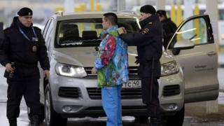 Russian police search a driver and his vehicle at the entrance to the Sochi Olympic park. Photo: 23 January 2014