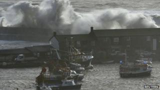 Waves crash over the Cobb at Lyme Regis