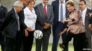 Dilma Rousseff kicks a ball at Arena das Dunas, Natal, Brazil on 22 January 2014