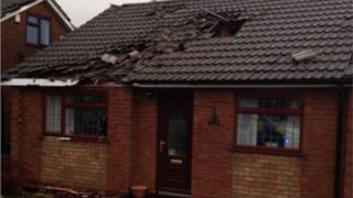 Police said five properties in Hickman Road were badly damaged and a number of others had roof tiles blown off.