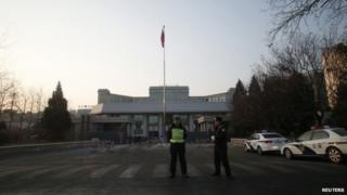 Policemen stand guard outside the Beijing No. 1 Intermediate People's Court, where Xu Zhiyong's trial is held, in Beijing, 26 January 2014