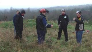 Trainees being instructed in use of strimmers