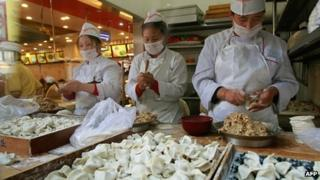 Dumpling makers in Beijing