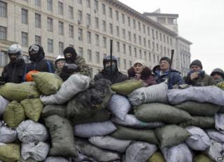 Protesters man a barricade in Kiev, 28 January