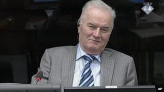 Former Bosnian Serb army commander Gen. Ratko Mladic smiles during his appearance at the Yugoslav war crimes tribunal Tuesday Jan. 28, 2014 in the Hague Netherlands.