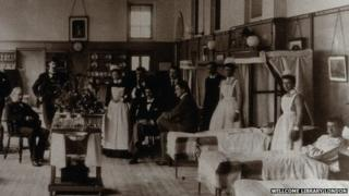 Baron Lister (seated) with his staff on Victoria ward, King's College Hospital in 1893.