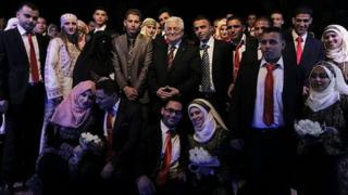 Palestinian President Mahmoud Abbas with couples in Jericho. 28 Jan 2014
