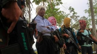 Bangsamoro Islamic Freedom Fighters (BIFF) spokesperson Abu Misri surrounded by fellow rebels on 29 January in Maguindanao province.