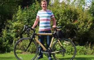 Hugh Allman with his bamboo bike