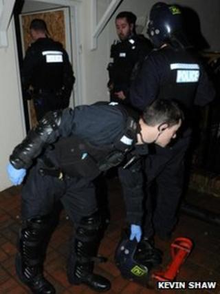 Officers on dawn raids