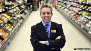 Justin King in a Sainsbury's supermarket aisle