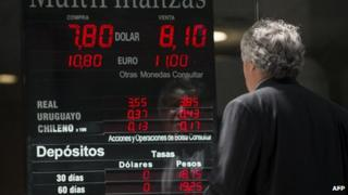 A man at a currency board