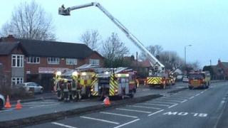Firefighters at car garage in Langley Mill, Derbyshire