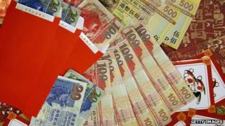 Red envelopes filled with Hong Kong dollars