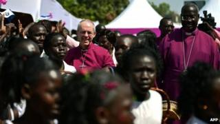 Archbishop of Canterbury Justin Welby (C) visits the ECS All Saints church in Juba, South Sudan on January 30, 2014.