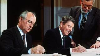 Mikhail Gorbachev and Ronald Reagan sign the INF in 1987