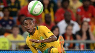Bongani Zungu of South Africa kicks a ball during an friendly match between South Africa and Spain in South Africa in November 2013