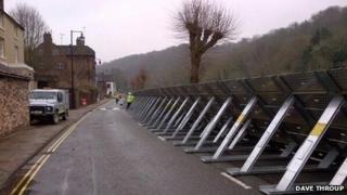 Erecting flood barriers