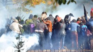 Riot police use tear gas to disperse people gathered outside a courthouse during an earlier trial of a police officer accused of killing a 26-year-old Turkish man in an anti-government protest in June in Ankara. Taken on 28 October 2013.