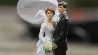 A model of a bride and groom