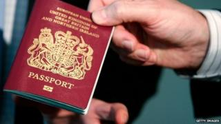 Man holds passport