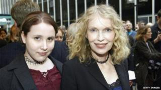 Dylan Farrow, shown with Mia Farrow in 2003, posing for a photo