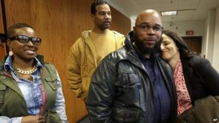 Gerard Richardson is hugged by Vanessa Potkin senior attorney at the Innocence Project, moments after Richardson was exonerated in Somerville, New Jersey 17 December 2013