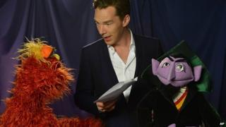 Benedict Cumberbatch with Muppets Murray and Count von Count