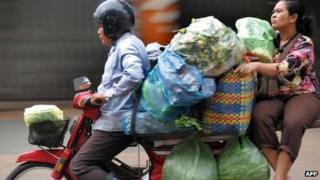 File image of heavily loaded motorbike in Phnom Penh