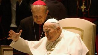 Pope John Paul II with Archbishop Stanislaw Dziwisz as he arrives in the Paul VI hall at the Vatican on 16 October 2003
