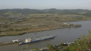 A ship leaves the Pedro Miguel locks on its route to Gatun lake in the Panama Canal near an area under construction as a part of its expansion project in Panama on 4 February, 2014