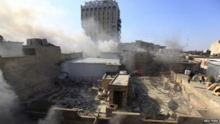 Smoke rises after a car bomb goes off in Khilani Square in central Baghdad, Iraq, on Wednesday