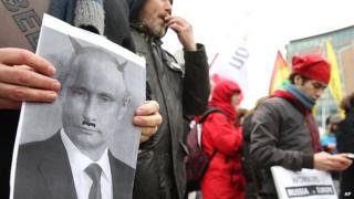 Gay rights protest in Brussels with photo of Vladimir Putin as a devil