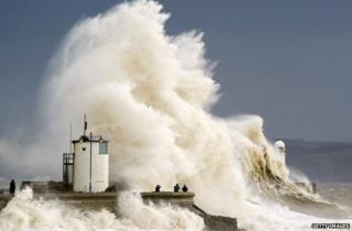 Huge waves crash into a wall