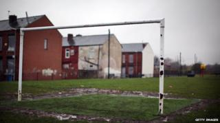 Goalposts on a pitch near homes