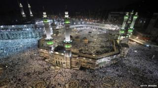 Pilgrims pray at the Grand Mosque in Mecca