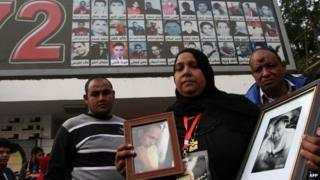 Parents of victims of the Port Said riot gather at a stadium in Cairo to mark the second anniversary (1 February 2014)