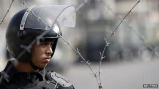 Egyptian police officer looks on at a protest