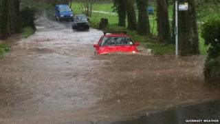 A car gets stuck in puddle