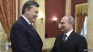 Russia's President Vladimir Putin (R) shakes hands with his Ukrainian counterpart Viktor Yanukovych before a reception to greet foreign guests prior to the 2014 Winter Olympic Games opening ceremony in Sochi, Russia, on Friday