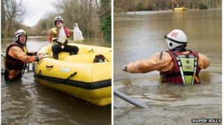 Firefighters help people trapped by floods in Wraysbury
