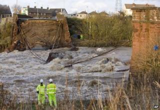 The collapsed bridge over the River Derwent in Workington after heavy rain and flooding in November 2009
