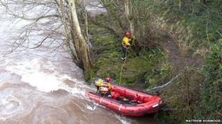 rescue team in river