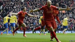 Liverpool's Martin Skrtel (R) celebrates scoring against Arsenal during their English Premier League soccer match at Anfield Stadium in Liverpool, northern England February 8, 2014.