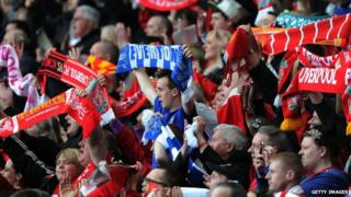 Fans holding scarves at 24th Hillsborough memorial service
