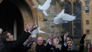 Doves released at church