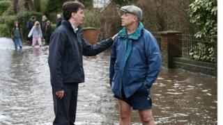 Ed Miliband meets resident of the Berkshire village of Wraysbury