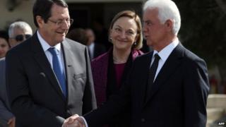 Cypriot President Nicos Anastasiades shaking hands with Turkish Cypriot leader Dervis Eroglu