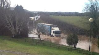 Lorry in water