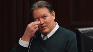 Defendant Michael Dunn reacts on the stand during testimony in his own defense during his murder trial in Duval County Courthouse in Jacksonville, Florida 11 February 2014